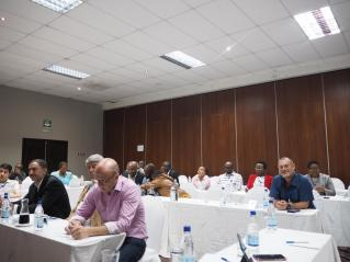 Many unidentified delegates – foreground from left to right – Dr Sizar Mohammad, Prof Nematollah Azizi, Prof Kamal Ketuly, Prof Phil Cotton; Right hand side blue shirt Dr Marius Venter, University of Johannesburg